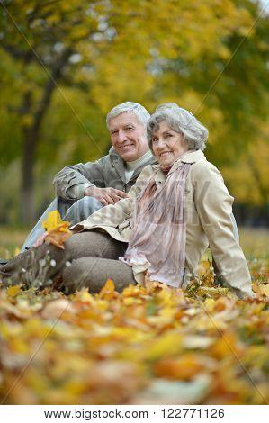 Mature married couple having fun on fresh air in autumn
