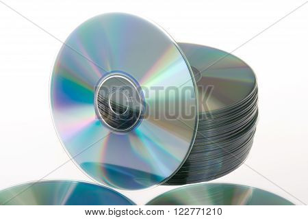 Stack Of Cds And Dvds On A White Background