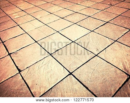 Abstract perspective background of empty textured square and flat light stucco gray and painted white pavement or plaster sidewalk outdoor. An old floor with retro style rows and dark seamless shapes