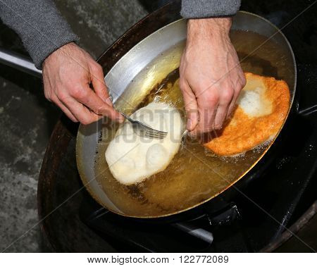 Fritters Dipped In Hot Oil In An Aluminum Pot
