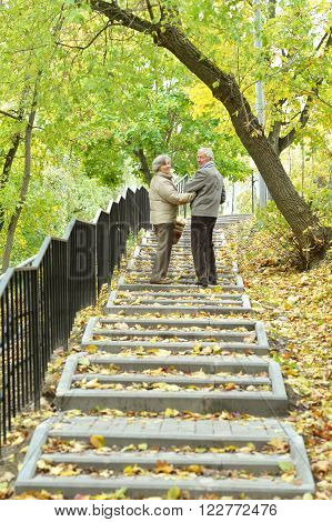 Mature married couple having fun on fresh air in autumn