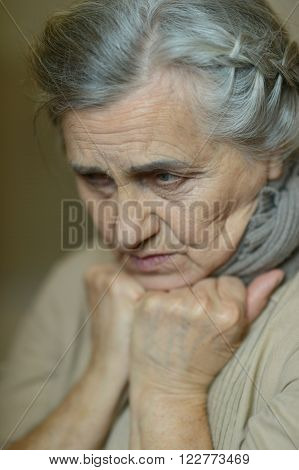 Portrait of a sad aged woman close-up