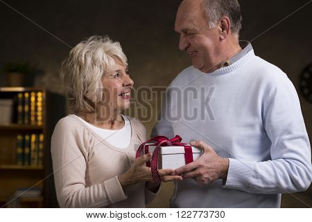 Shot of an elderly couple exchanging gifts