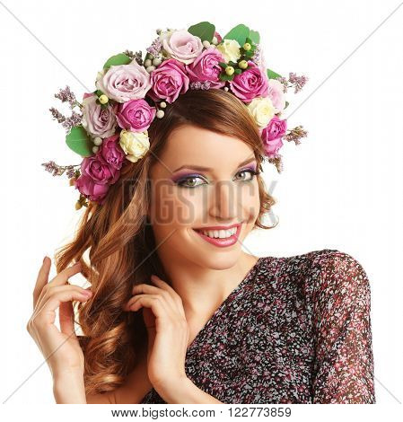 Beautiful young woman wearing floral headband isolated on white background