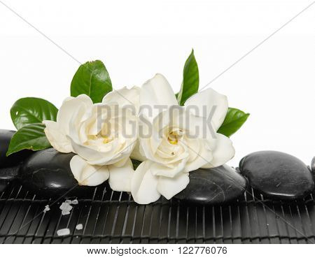 Set of with stones and gardenia on bamboo mat