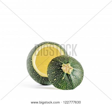 Eight ball squash with cut top and scooped out pulp isolated on white.