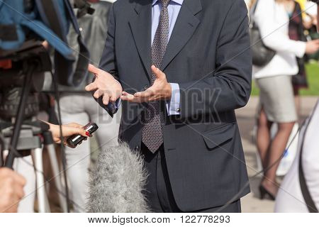 TV reporter making media interview with politician or businessman