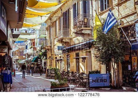 NICOSIA, CYPRUS - DECEMBER 3: People walking on Onasagorou street, popular tourist sidewalk in central Nicosia, Cyprus on December 3, 2015 in Nicosia