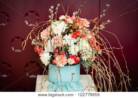 Basket Of Spring Flowers On A Wooden Chair