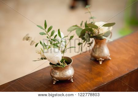 Three Small Vase With Flowers Standing Near