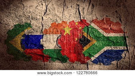 BRICS - association of five major emerging national economies members flags on gears. Concrete textured. Trade union