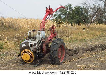 DIKANKA UKRAINE - SEPTEMBER 30 2015: Plowing garden tractor motor-block Motor Sich MB-405