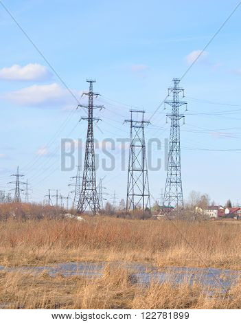 Early spring landscape with electric power line transmission outskirts of St.Petersburg Russia.