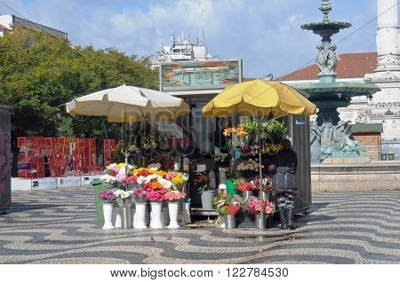 LISBON, PORTUGAL - FEBRUARY 15: seller of flowers on the Rossio Square in Lisbon February 15, 2016