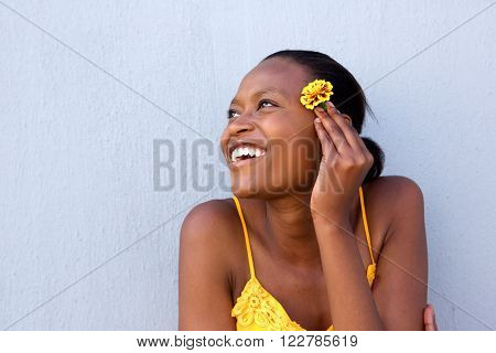 Smiling Young African Lady Holding A Flower