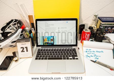 PARIS FRANCE - MARCH 21 2016: Apple Computers website on MacBook Pro Retina in a geek creative room environment showcasing the newly announced iPad pro and its resolution of 2048x1536