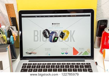 PARIS FRANCE - MARCH 21 2016: Apple Computers website on MacBook Pro Retina in a geek creative room environment showcasing the newly announced Apple Watch trendy fashion bands