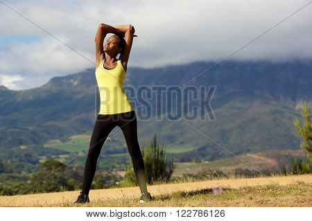 Fit Young African Woman Doing Stretching Workout