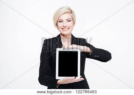 Smiling businesswoman showing blank tablet computer screen isolated on a white background