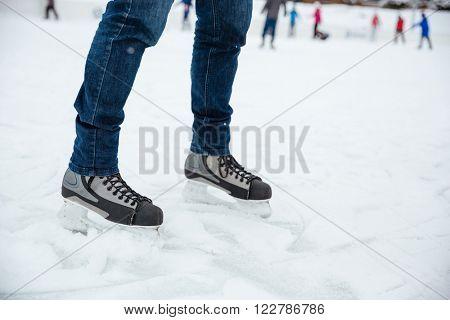 Closeup portrait of a man's legs in ice skates