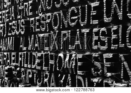 BARCELONA - FEBRUARY 24: The inscripted entrance door is printed with words from the Bible in various languages at the Sagrada Familia created by Gaudi on February 24 2016 in Barcelona Spain