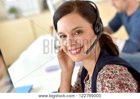 Portrait of smiling customer service operator