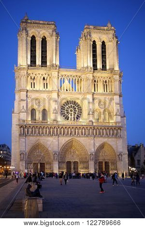 PARIS, FRANCE - SEP 11, 2014: The facade of Notre Dame Cathedral on Cite Island at night time