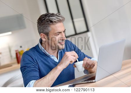 Man working from home-office with laptop computer