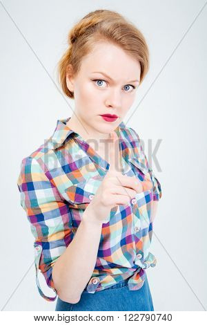 Angry woman wagging finger isolated on a white background