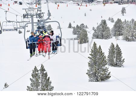 Family at ski resort sitting in chairlift