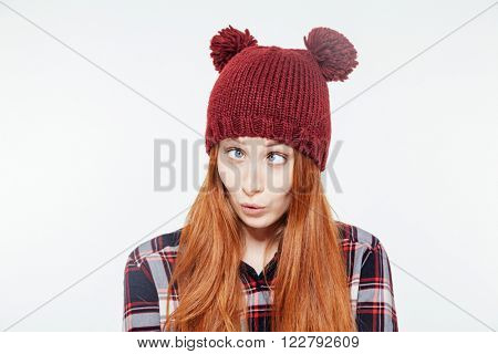 Woman with funny face posing isolated on a white background