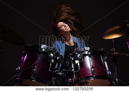 Female drummer playing the drums