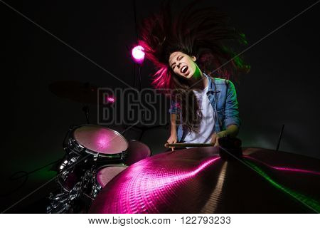 Beautiful woman playing the drums