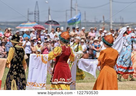 SMALL CHAPURNIKI, VOLGOGRAD, RUSSIA - MAY 24: Young boys and girls dressed in traditional costumes dancing folk dances at the celebration of the Sabantuy. May 24, 2014 in Volgograd, Russia.