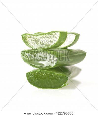 Fresh sliced aloe vera leaves isolated on white background