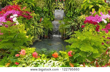 water Fall and Flower beds in the Spring with Lush colors, Victoria, Canada