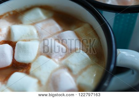 Close-up shot of two mugs of hot cacao with marshmallow