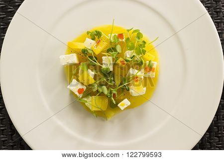 Golden beetroot cappachio with goat's cheese, baby watercress & smoked paprika oil