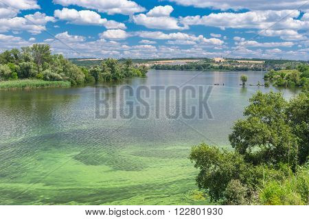 Summer landscape with Dnepr river covered with cyanobacterias near Dnepropetrovsk city Ukraine