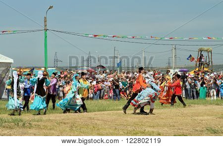SMALL CHAPURNIKI VOLGOGRAD RUSSIA - MAY 24: Men and women in national costumes dance traditional folk dances in celebration of the holiday Sabantuy. May 24 2014 in Volgograd Russia.