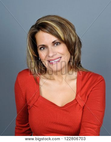 Portrait of a Beautiful Mature Woman wearing a Red Sweater