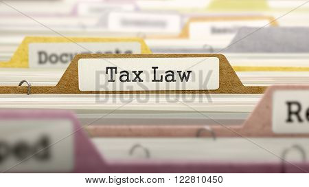 Folder in Colored Catalog Marked as Tax Law Closeup View. Selective Focus. 3D Render.