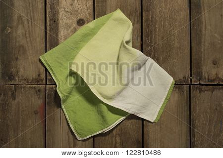 Gradient Green Towel On Wooden Panel Surface