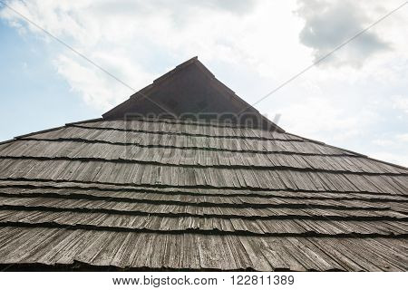 Old wooden shingle roof against the sky. Old traditional Ukrainian architecture. ** Note: Visible grain at 100%, best at smaller sizes