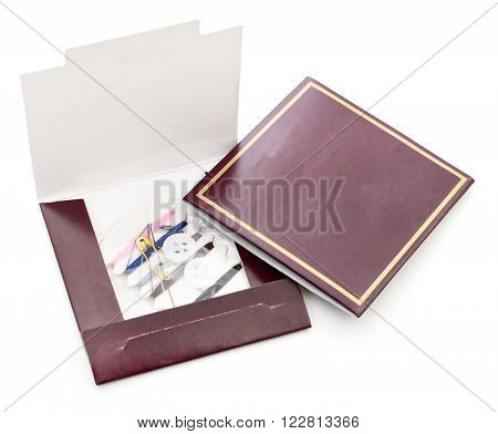 Small sewing kit isolated on white backgrond.