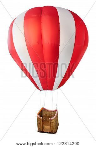 Model red and white striped hot air balloon with empty suspended wicker basket isolated on a white background