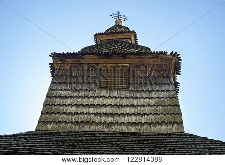 Dome and cross of the ancient wooden church (XVIII century) in the village Huklyvy in the Ukrainian Carpathians.