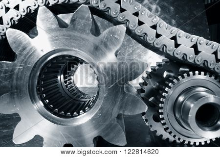 titanium and steel cogwheels and gears powered by chains