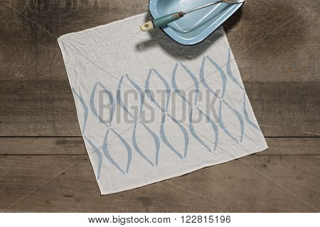 Square Table Napkin With Blue Concave Lines Alongside Blue Tray