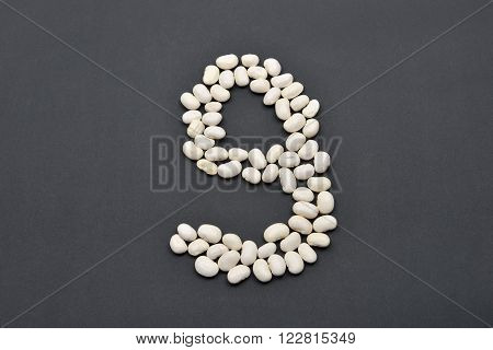 Number Nine Made From White Beans On Black Background. Food Vegan, Vegetarian. Healthy Food